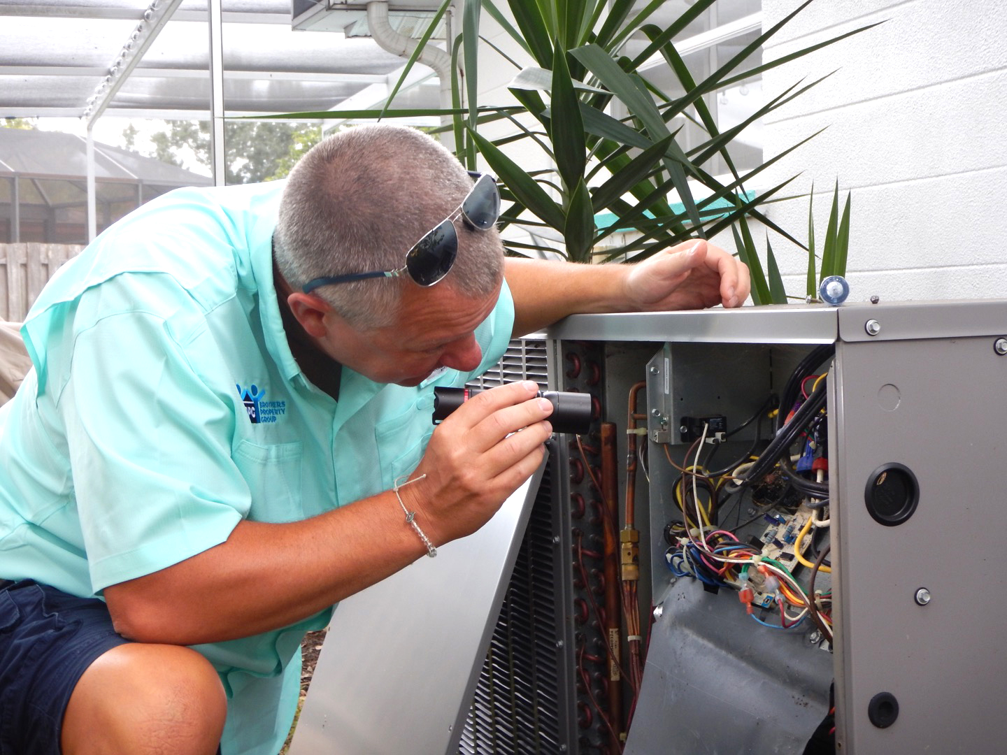 home inspector checking electrical